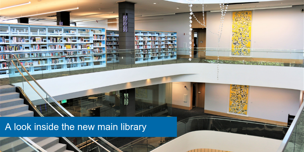 A look from the third floor in the new main library. Books on the shelves and artwork