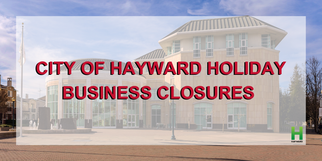 Hayward City Hall on a clear day with the words City of Hayward Holiday Business Closure on top