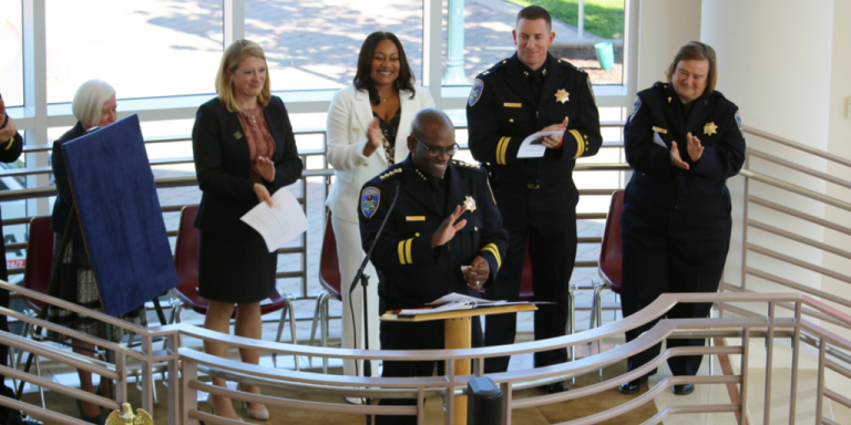 Chief Chaplin smiling at a podium during his swearing in