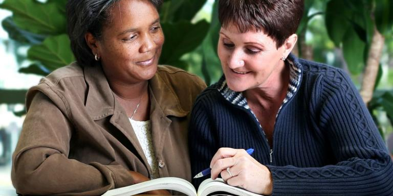 Adult reading tutor and student