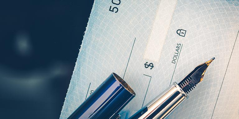Issuing a blue check with a blue pen