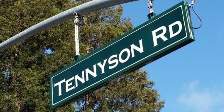A green Tennyson Road sign