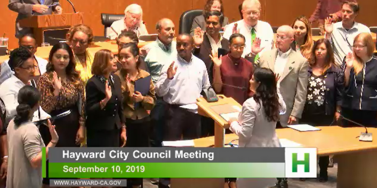 New and returning commissioners take their oath in front of the City Council