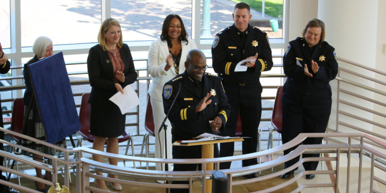 Chief Toney Chaplin smiling and clapping during the ceremony