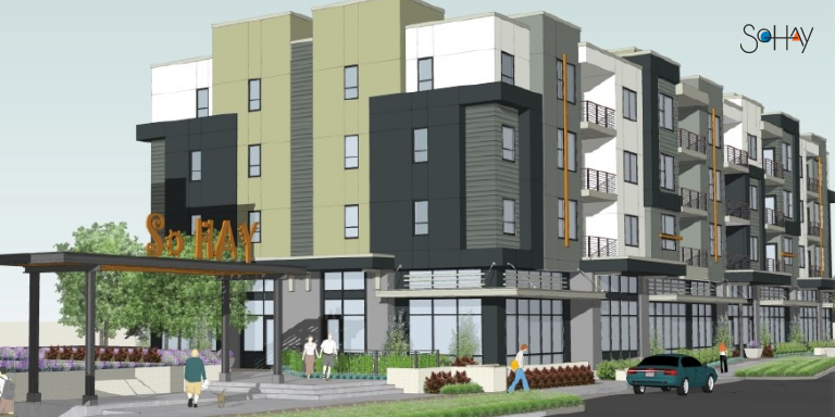 """Rendering of a grey, white, and black apartment building with shrubs and trees surrounding the sidewalk. A sign on an overhang reads """"So Hay."""""""