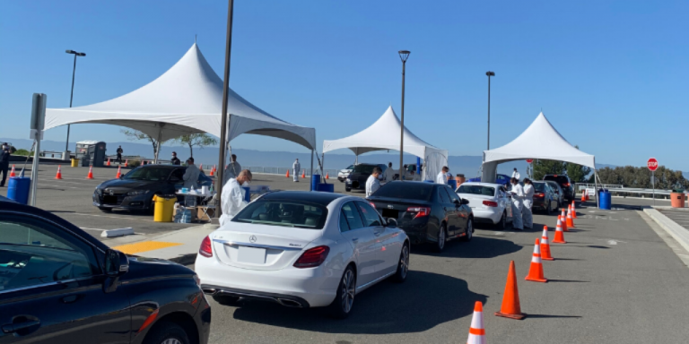 A line of cars at the outside testing center