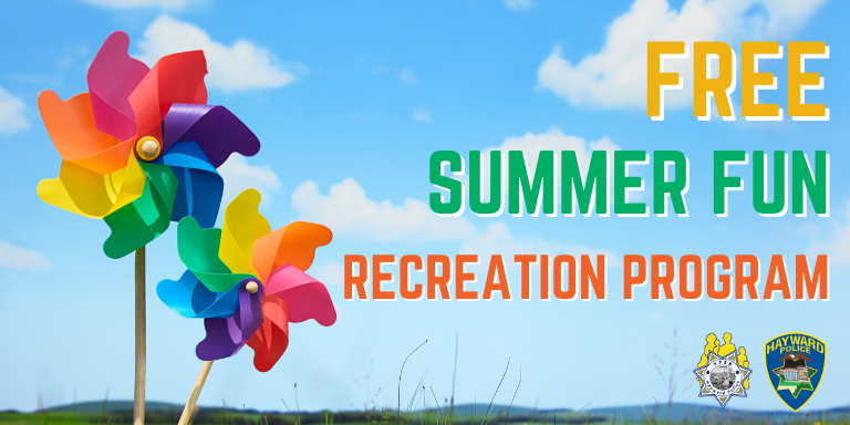 Two brightly colored pinwheels next to the text: Free Summer Fun REcreation Program