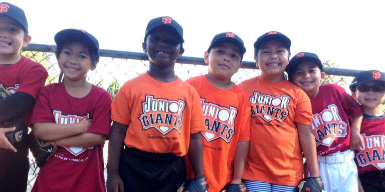 Children wearing Junior Giants Tee Shirts smiling