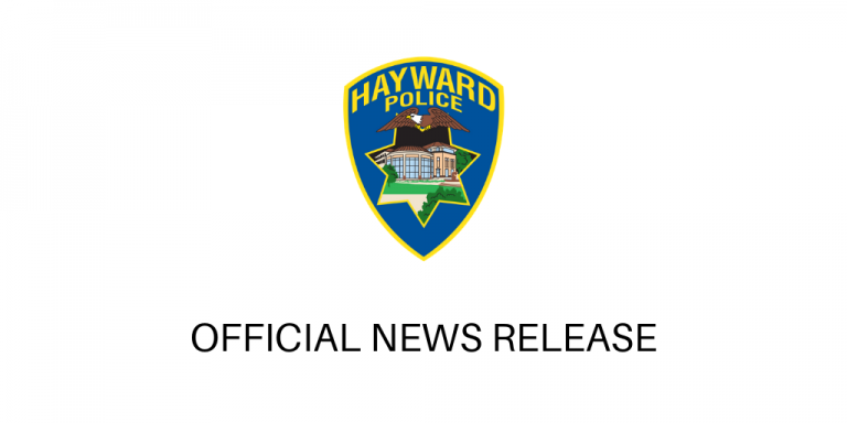 Police shield on a white background above the words official news release