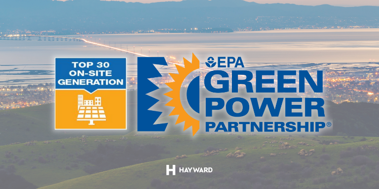 Photo of the Hayward Hills and a view of the City and San Mateo bridge at dusk. On top of it text: Top 30 On-Site Generation. EPA Green Power Partnership.
