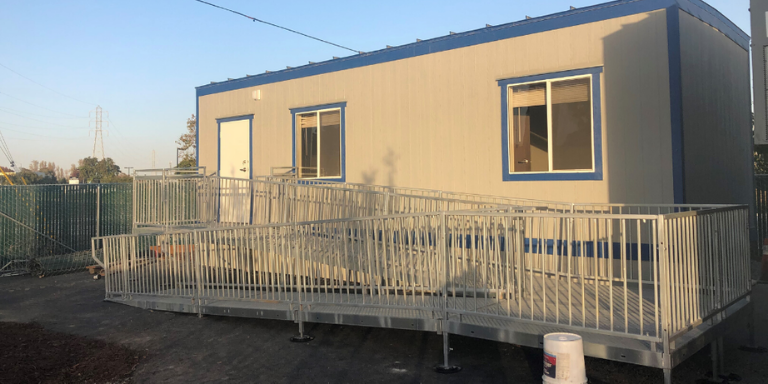 Grey and blue portable building
