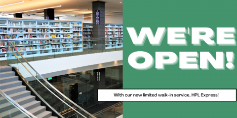 The second floor of the Downtown Library next to the text: We're open